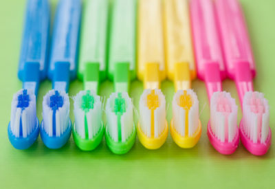 Colorful tooth brushes in bright neon colors